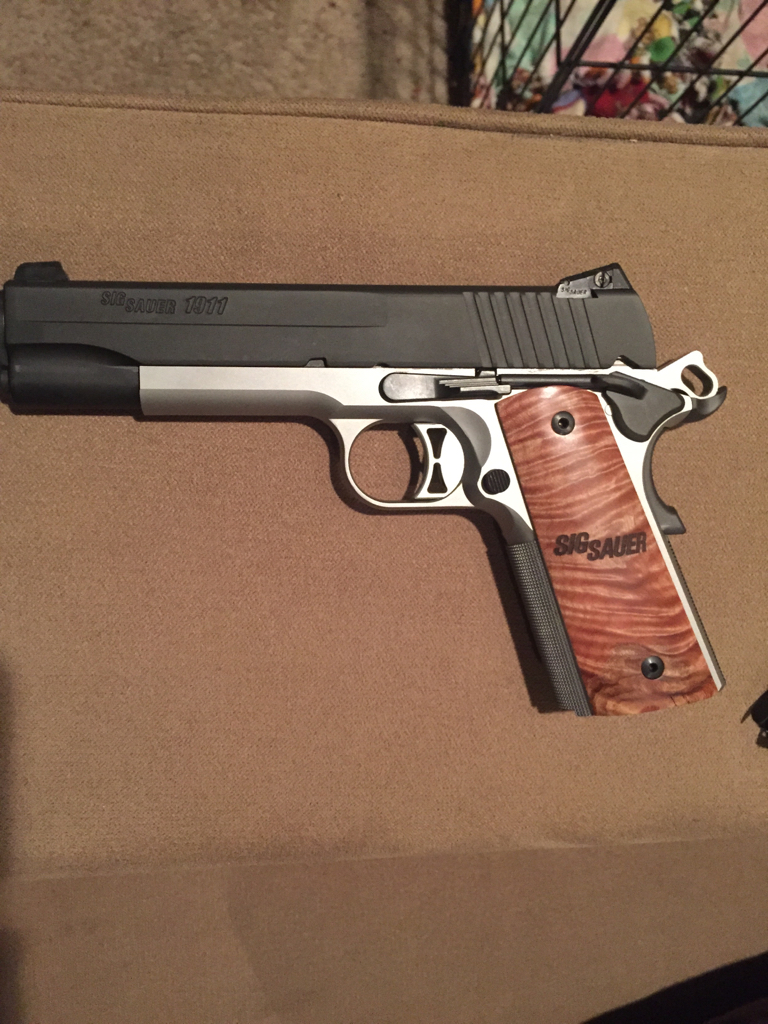 It looked lonely in the case - 1911 Forum